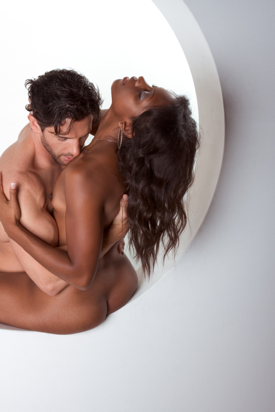 Naked man and woman in bed