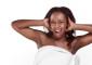 Black woman wrapped in bath towel screaming