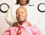 Businesswoman giving businessman massage