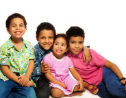 Close-up of group of happy brothers and sisters, smiling, laughing, hugging