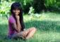 Beautiful ethnic woman relaxing in park